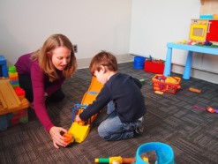 Amanda Gulsrud, PhD, from UCLA, works with a child with autism.